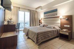 Un ou plusieurs lits dans un hébergement de l'établissement Messonghi Beach Holiday Resort