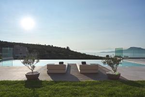 The swimming pool at or near Villa Niolos II