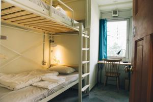 A bunk bed or bunk beds in a room at Nui. HOSTEL & BAR LOUNGE