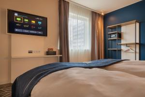 A bed or beds in a room at the niu Ridge