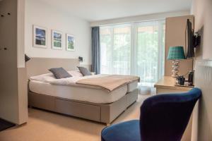 Кровать или кровати в номере Pension-Restaurant Stilec