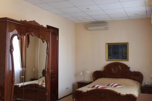 Кровать или кровати в номере Отель Соболь