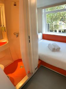 A bed or beds in a room at easyHotel South Kensington