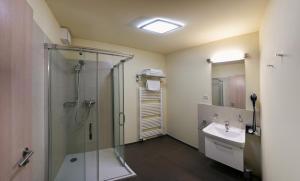 Ein Badezimmer in der Unterkunft Hotel Monínec