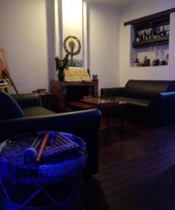 A seating area at hostal casa del frailejon