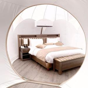 A bed or beds in a room at Wadi Rum Bubble Luxotel