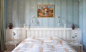 Säng eller sängar i ett rum på Vätternterrassen