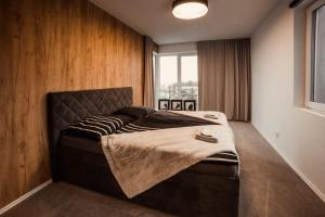 Posteľ alebo postele v izbe v ubytovaní VELVET APARTMENTS