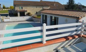 A view of the pool at Le Coteau de Bazeille Spa & Sauna or nearby