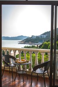 A balcony or terrace at Pousada de Coloane Boutique Hotel