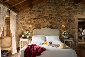 A bed or beds in a room at A Casa da Torre Branca