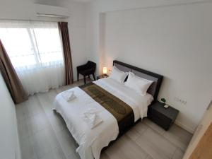 A bed or beds in a room at Bodaiju Residences