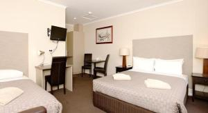 A bed or beds in a room at Ballarat Central City Motor Inn