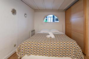 A bed or beds in a room at NOCNOC- L'Escale