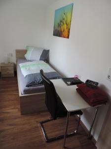Ein Bett oder Betten in einem Zimmer der Unterkunft Pension am Kirchberg