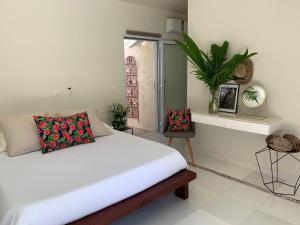 Cama ou camas em um quarto em Villa Royal Palms Moorea and studio