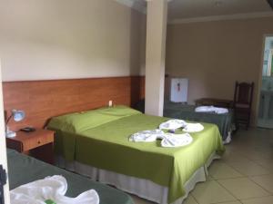 Cama ou camas em um quarto em Pousada A Violeira