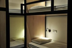 A bunk bed or bunk beds in a room at Life Sabah Hostel