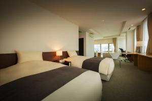 A bed or beds in a room at Villa Concordia Resort & Spa