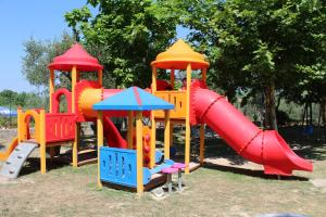 Children's play area at Happy Camp Mobile Homes in Camping Cisano San Vito