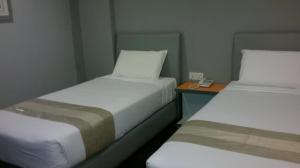 A bed or beds in a room at U Pac Hotel