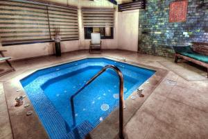 المسبح في  فندق و سبا افريكانا أو بالجوار
