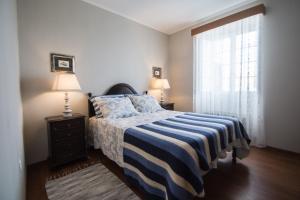 Uma cama ou camas num quarto em Casa da Avó - Vila do Porto