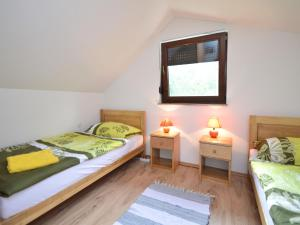 A bed or beds in a room at Holiday Home Patrik