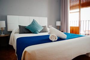 A bed or beds in a room at Nest Style Granada