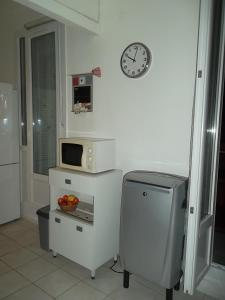 A television and/or entertainment centre at Appartement Malo