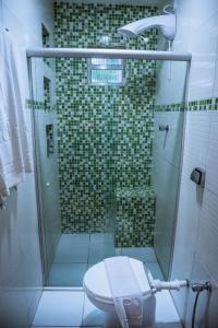 A bathroom at Hotel Aconchego