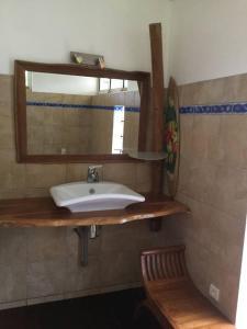 Um banheiro em Maison TEREVA