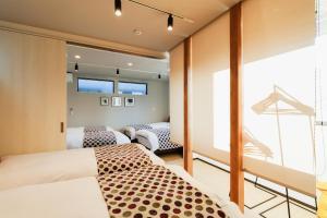 MALLOWK in Kanazawaにあるベッド