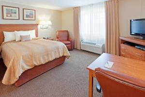 A bed or beds in a room at Candlewood Suites Watertown Fort Drum, an IHG Hotel