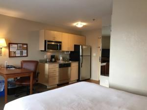 A kitchen or kitchenette at Candlewood Suites Watertown Fort Drum, an IHG Hotel