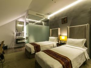 A bed or beds in a room at Bliss Hotel Singapore (SG Clean, Staycation Approved)