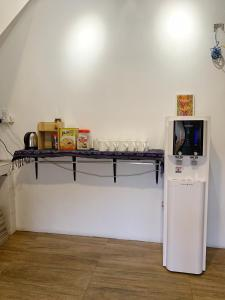 A kitchen or kitchenette at Hornbill's Nest Kuching