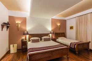 Ein Bett oder Betten in einem Zimmer der Unterkunft Areindmar Hotel