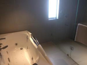 A bathroom at The Lotus Hotel Sameera