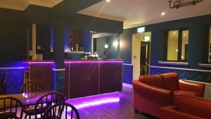 The lounge or bar area at The Old SchoolHouse Hotel