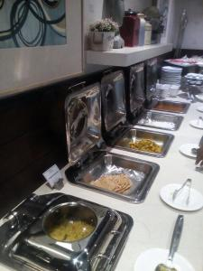 A kitchen or kitchenette at Hotel Ajmer Tower