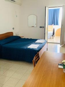 A bed or beds in a room at FONTANA DI PAPA AL 12°