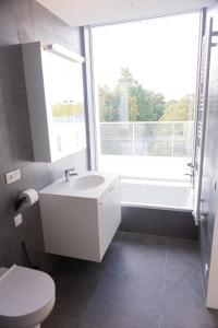 Een badkamer bij Hotel Den Briel