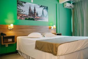 A bed or beds in a room at Tri Hotel Smart Criciuma