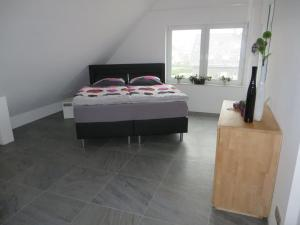 A bed or beds in a room at Apartment in toller Lage am Rande des Ruhrgebietes