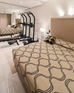 A bed or beds in a room at Hotel Ariston