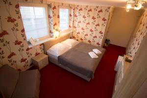 Posteľ alebo postele v izbe v ubytovaní Penzión Galéria