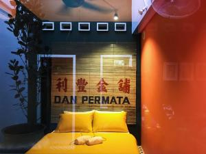 A bed or beds in a room at Hostel Ah Wai, Hostel Ah Zhi