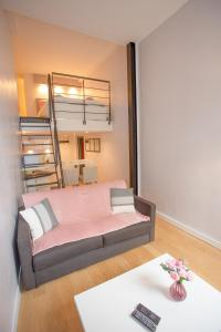 A bed or beds in a room at Le Duplex
