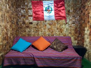 A bed or beds in a room at Huachuma Guest House